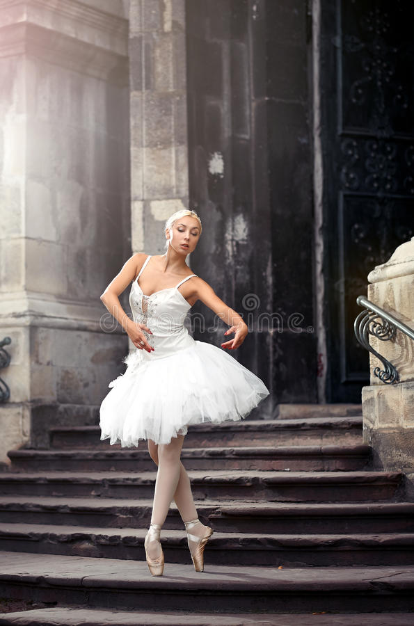 Beautiful ballet woman on stairs royalty free stock photography