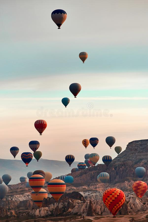 Mountain landscape with large balloons in a short summer season at dawn stock photography