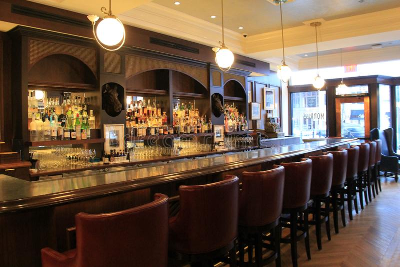 Download Beautiful Bar Set Up With Well Stocked Cabinets, Morrissey`s,
