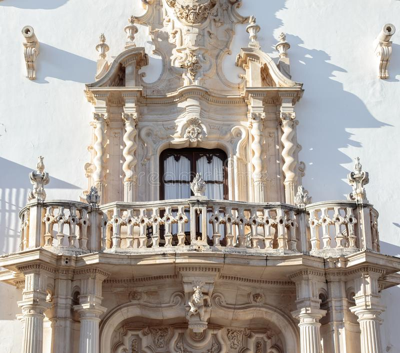 Beautiful baroque balcony of the Marques de la Gomera Palace in Osuna. Ducal town declared a Historic-Artistic Site. Southern Spain. Picturesque travel royalty free stock photo