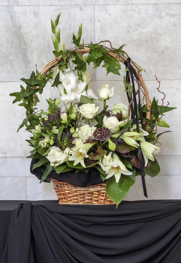 Beautiful basket of flowers, funeral bouquet stock image