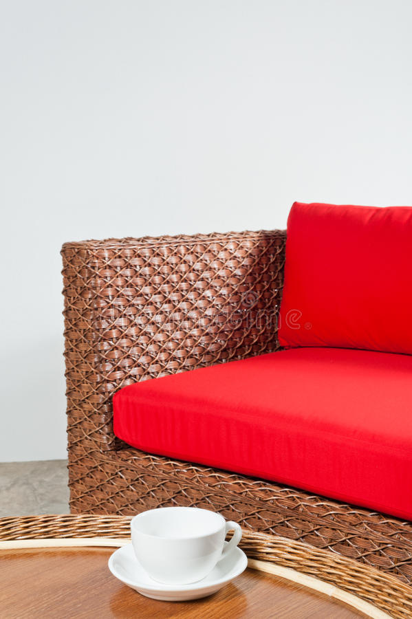Beautiful basketwork furniture. In front of white bright wall stock images