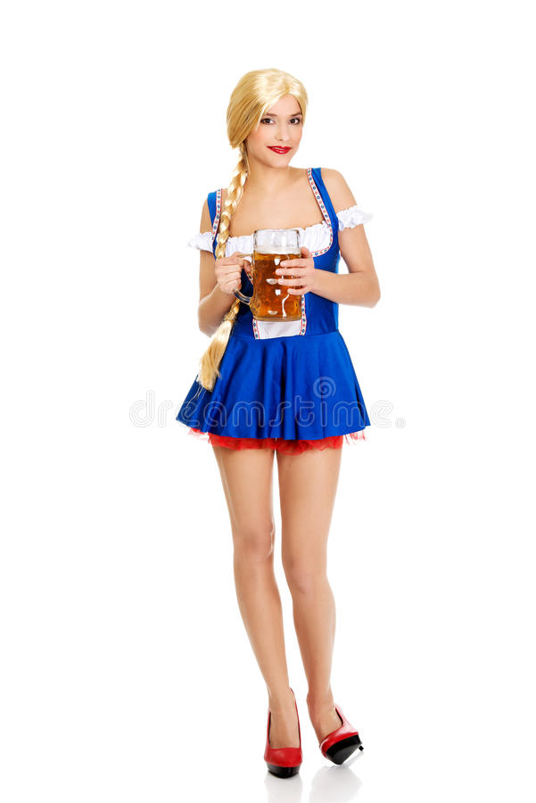 Beautiful bavarian woman with beer. Young and beautiful bavarian woman with beer royalty free stock photos