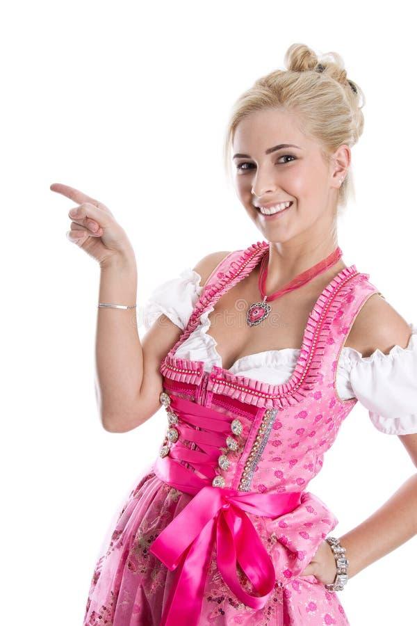Beautiful bavarian woman isolated making promotion for Oktoberfest in munich. Beautiful bavarian woman isolated making promotion for Oktoberfest in munich stock image