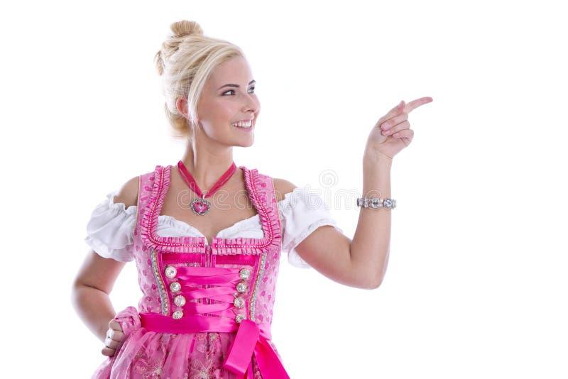 Beautiful bavarian woman isolated making promotion for Oktoberfest in munich. Beautiful bavarian woman isolated making promotion for Oktoberfest in munich stock photos