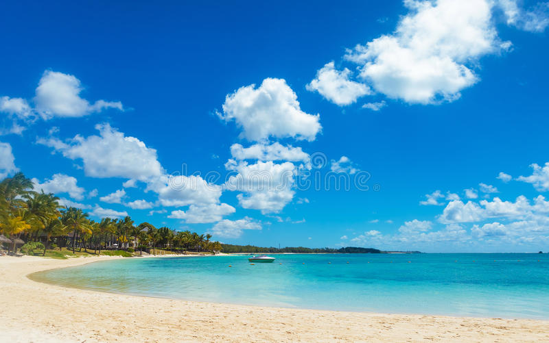 Beautiful bay in mauritius island with speed boat. In sunny summer day stock photos
