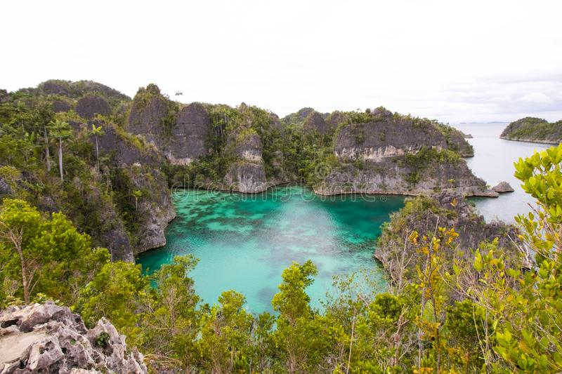 beautiful bay in the shape of star in piaynemo island, raja ampat archipelago stock photography