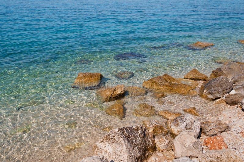 Beautiful beach with big stones in Podgora, Croatia royalty free stock photo
