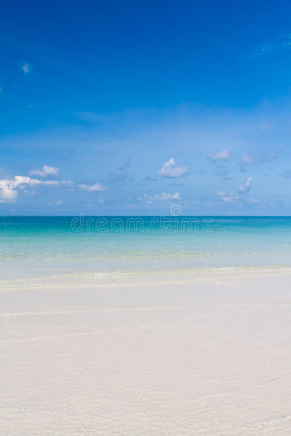 Beautiful beach and blue sky in thailand vertical royalty free stock photo