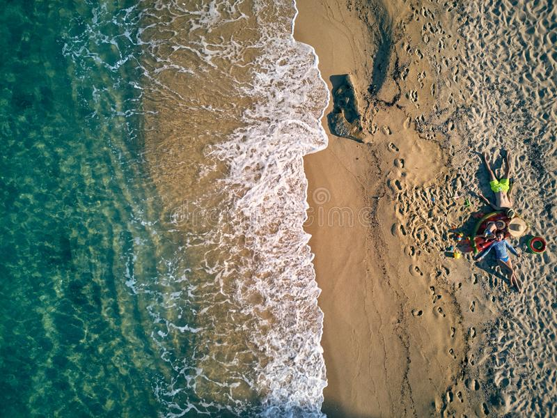 Beautiful beach with family top view shot. Beautiful beach with family top aerial view drone shot, Sithonia, Greece stock photo