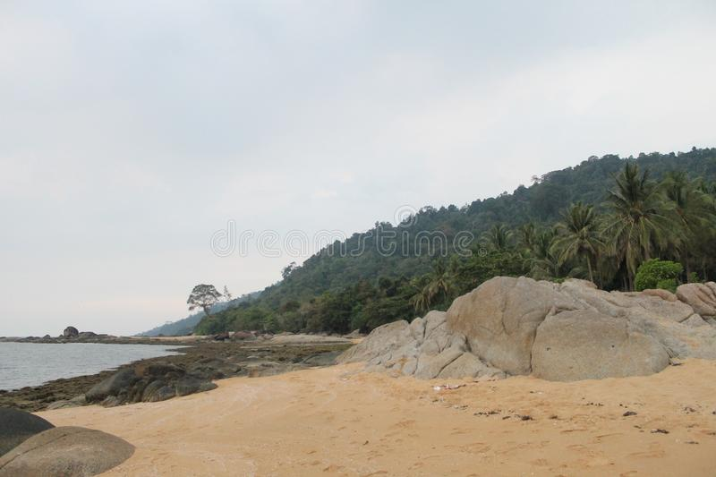 Beautiful Beach and Stone Indonesia Temajuk. Beautiful beach, holiday of Temajuk, Borneo Indonesia royalty free stock image