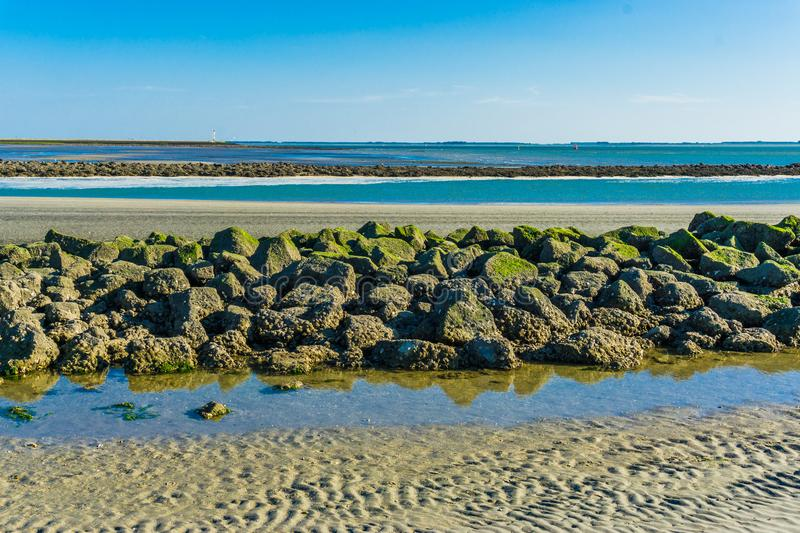 Beautiful beach landscape with a line of rocks stacked. A beautiful beach landscape with a line of rocks stacked stock photo