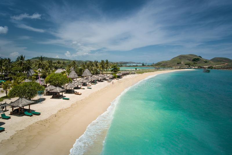 Beautiful beach in Lombok, Indonesia seen from above. Mandalika beach is one of the most beautiful beaches of Lombok seen from the sky. Blue ocean and white stock photography