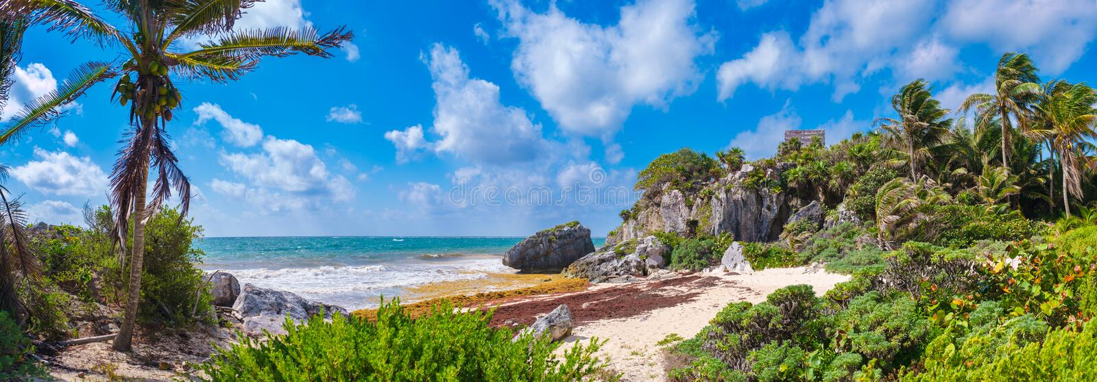 Beautiful beach and mayan ruins on a cliff at Tulum in Mexico stock images