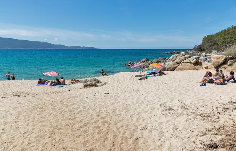 Beautiful beach near Propriano. Corsica island west coast, France. PROPRIANO, FRANCE - JULY 17, 2019: People visit beautiful summer sandy beach on the Corsica stock image