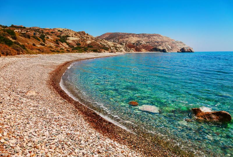 Beautiful beach on Petra tou Romiou (The rock of the Greek), Aphrodite& 39;s legendary birthplace in Paphos, Cyprus island,. Mediterranean Sea. Amazing blue royalty free stock photos