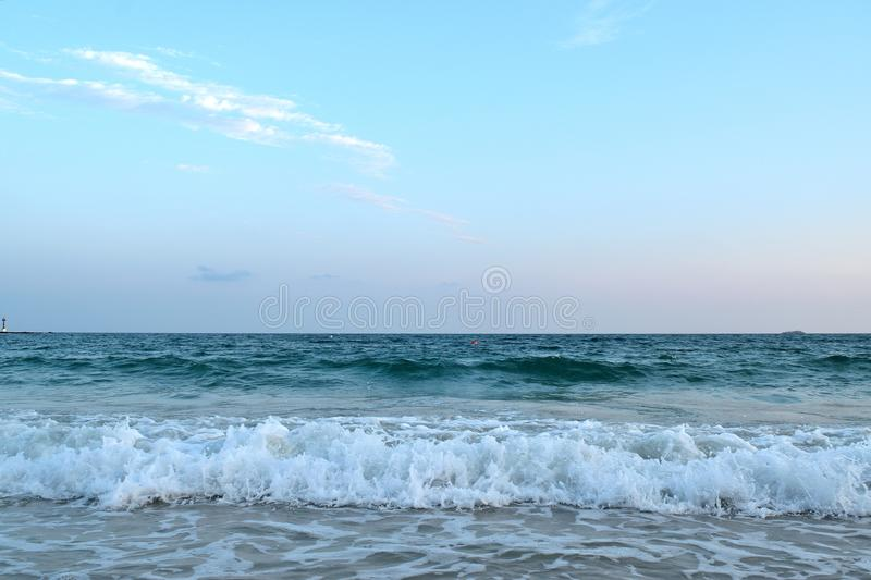 Beautiful beach with sea wave ocean on blue sky. And Background / Landscapes stock image