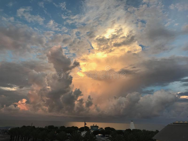 Amazing sunlit thunderstorm along the coast royalty free stock images