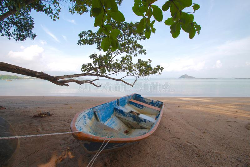 Beautiful beach with small boat stock image