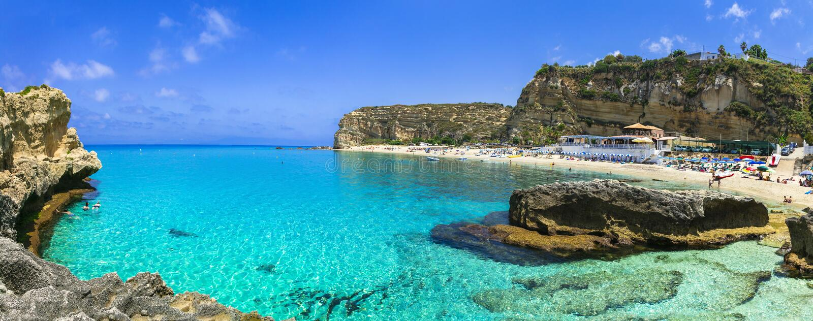 Beautiful turquoise sea and great beaches of Calabria. Oasi beach near Tropea town royalty free stock photos
