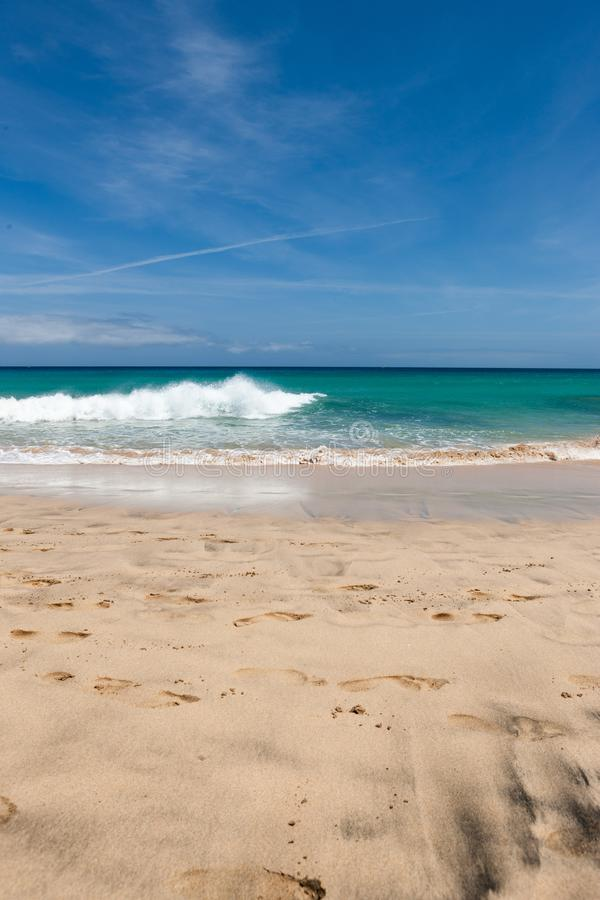 A beautiful beach with turquoise water and a blue sky stock photos