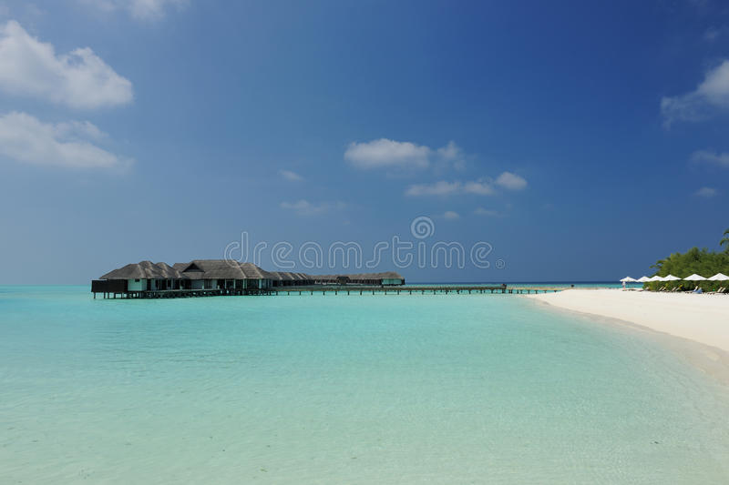 Beautiful beach with water bungalows stock images
