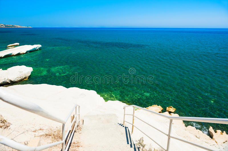 Beautiful beach with white cliff and blue sea royalty free stock photography