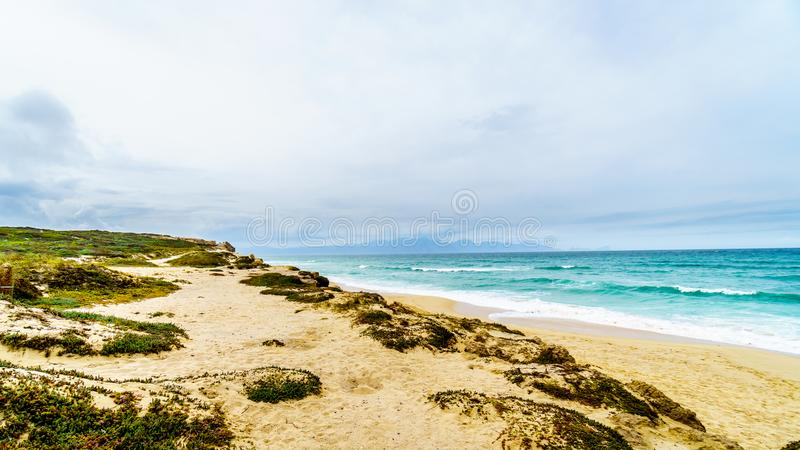 The beautiful beaches on False Bay along Baden Powell Drive between Macassar and Muizenberg near Cape Town royalty free stock image