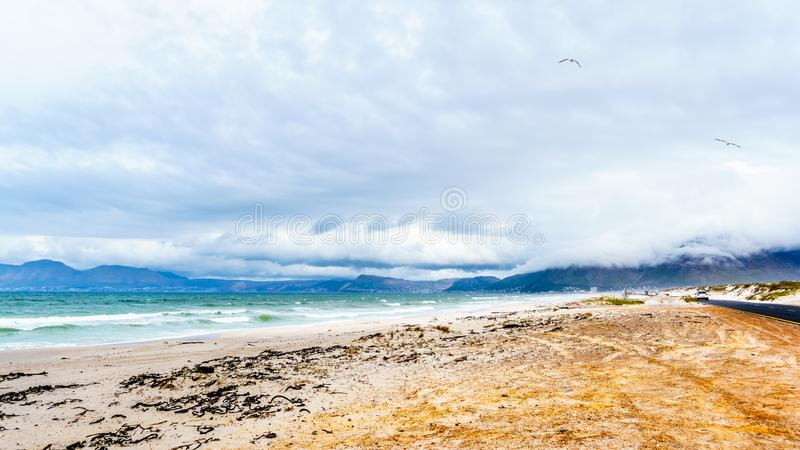 The beautiful beaches on False Bay along Baden Powell Drive between Macassar and Muizenberg near Cape Town royalty free stock photography