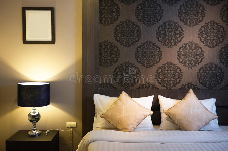 Beautiful Bedroom Interior in New Luxury Home. Hotel bedroom royalty free stock images
