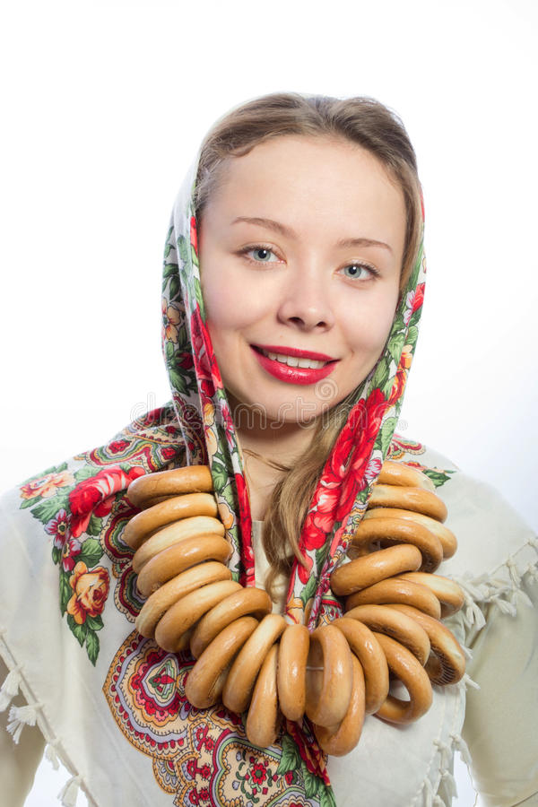 Beautiful belarusian woman with bread-rings stock photography