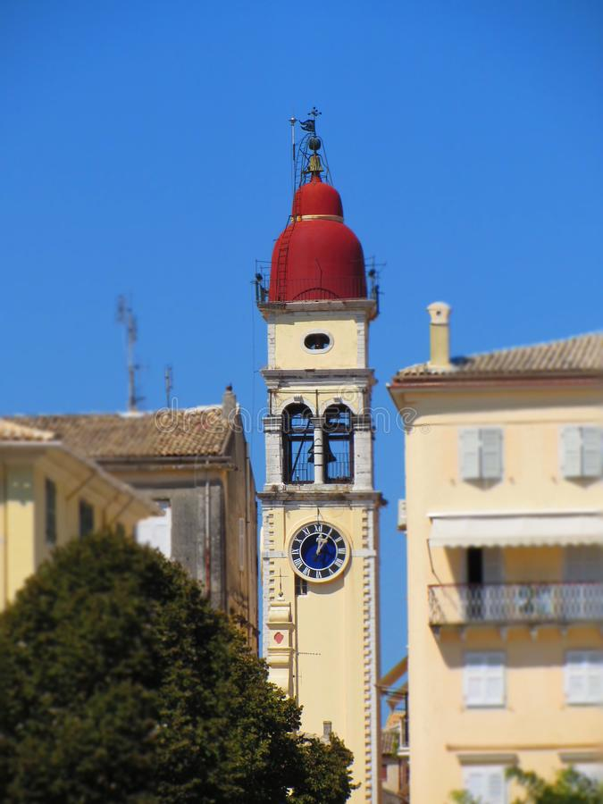 Beautiful bell tower of St. Spyridon`s Cathedral on the small street of Corfu. Greece. royalty free stock photography
