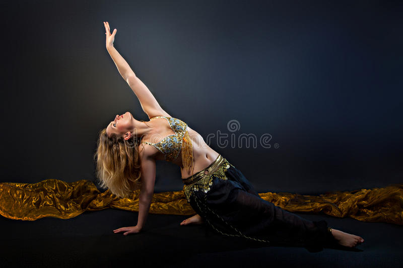 Beautiful belly blonde dancer. Dancing stock photography