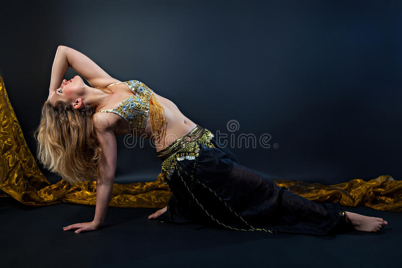 Beautiful belly dance. In action royalty free stock images