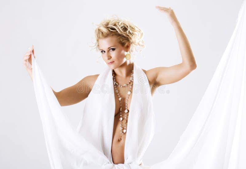 Beautiful belly dancer high key. Beautiful belly dancer female dancing in high key royalty free stock photo