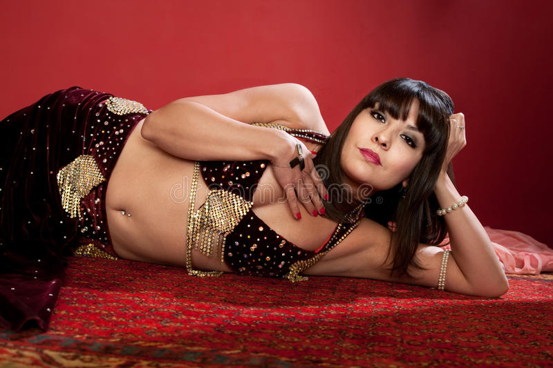 Beautiful Belly Dancer Lying Down royalty free stock photo