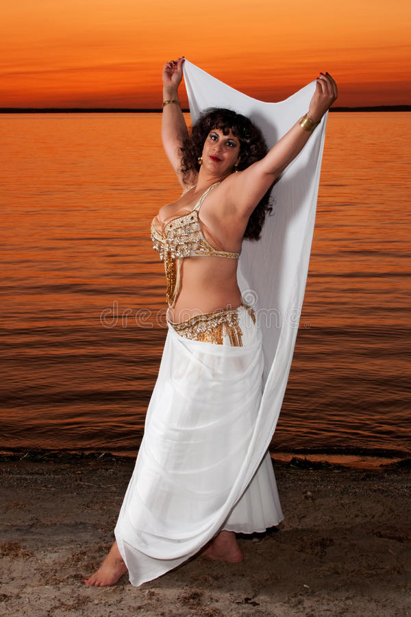 Download Beautiful Belly Dancer On The Sand Royalty Free Stock Image - Image: 10935596