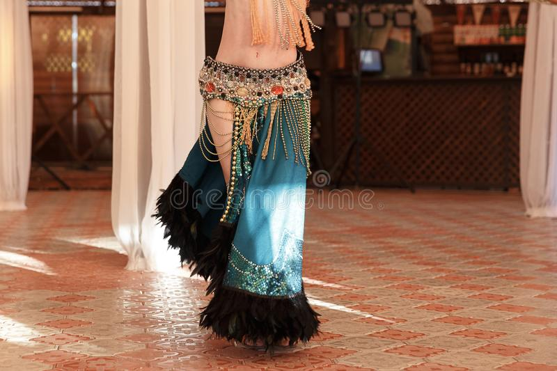 Beautiful belly dancer young woman in gorgeous red and green costume dress royalty free stock photos