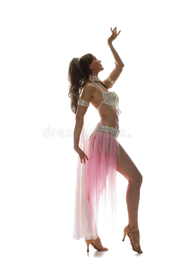 Beautiful bellydancer. Isolated on white royalty free stock image