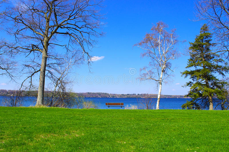 A beautiful bench by the lake stock photography