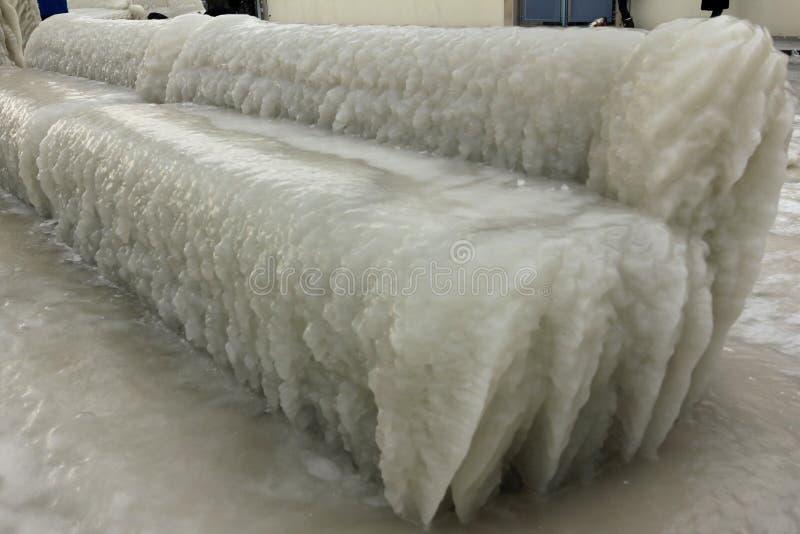 Beautiful bench trapped in ice in Versoix Switzerland 免版税库存图片