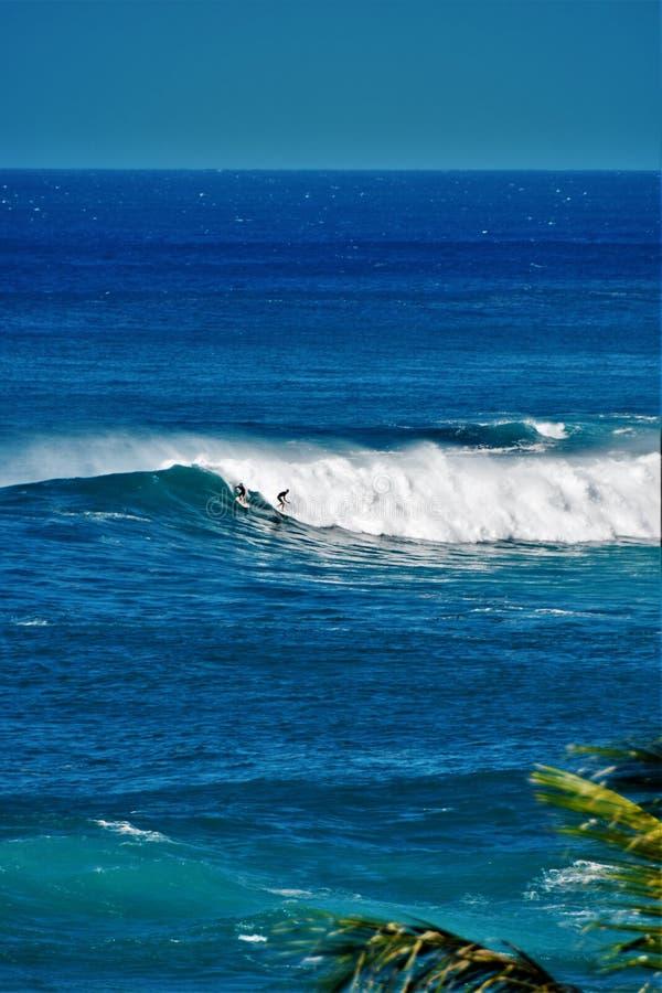 Big Waves at Waimea Bay, Oahu, Hawaii, USA. Beautiful big blue waves, surfing at Waimea Bay in Oahu, Hawaii, USA royalty free stock photos