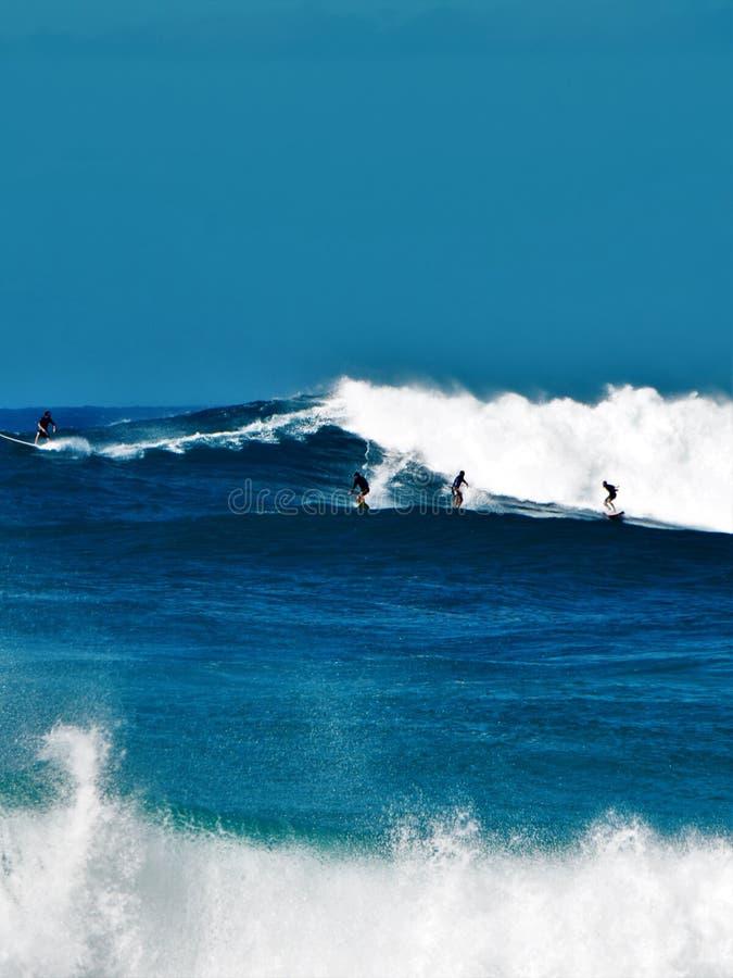 Big Waves at Waimea Bay, Oahu, Hawaii, USA. Beautiful big blue waves, surfing at Waimea Bay in Oahu, Hawaii, USA stock images