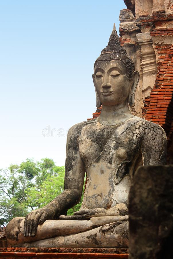 Beautiful Big Buddha sculpture in the ruins of the historic temple Wat Phra Sri Sanphet. Ayutthaya, Thailand. stock image