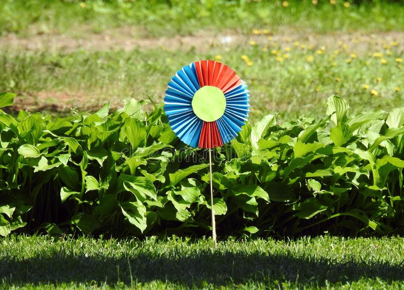 Colorful flower made from paper in children garden, Lithuania royalty free stock photos