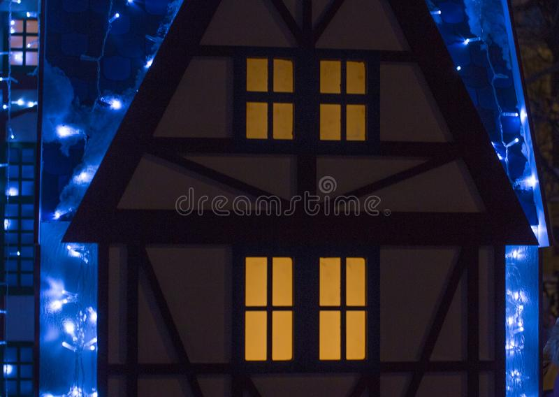 Beautiful big house decorated with Christmas lights. Large Windows with Christmas tree. stock images