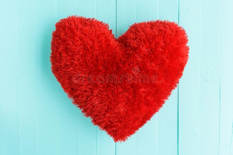 Beautiful big red pillow heart shape. On white and pink wooden background. Love, Wedding and Valentines day concept stock images