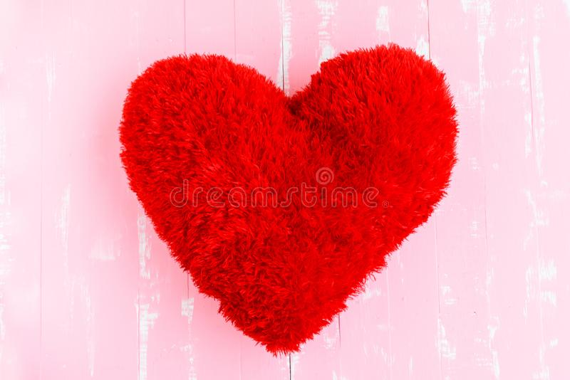 Beautiful big red pillow heart shape on white and pink wooden. Background. Love, Wedding and Valentines day concept stock photos