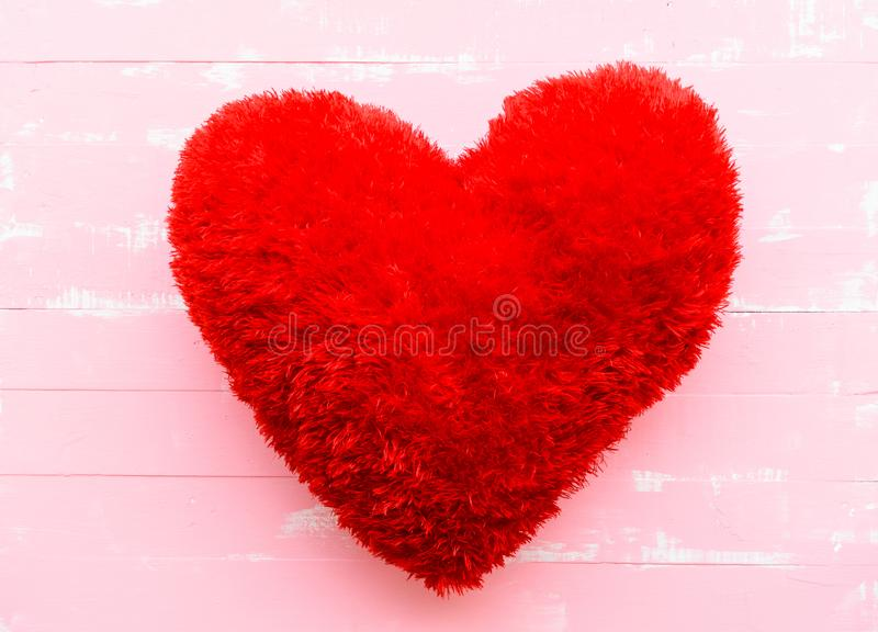 Beautiful big red pillow heart shape on white and pink wooden. Background. Love, Wedding and Valentines day concept royalty free stock image