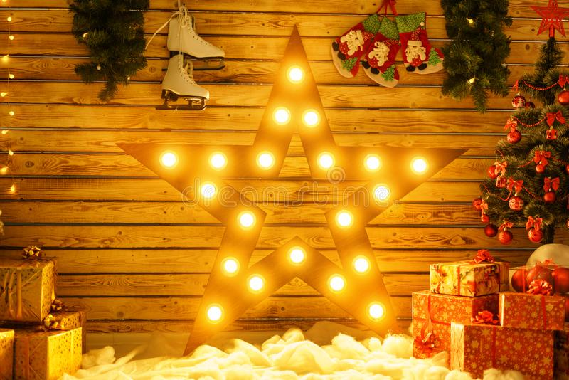 Beautiful big star stands against the wall and glows, glowing Christmas decor.  royalty free stock photography